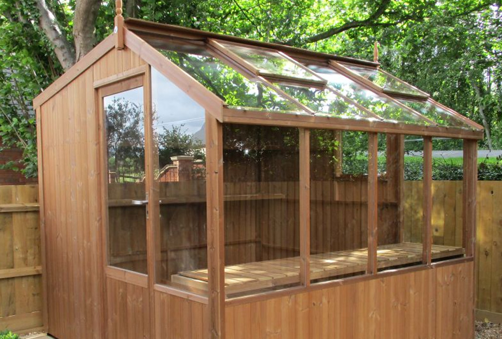 wooden potting shed with glazed roof
